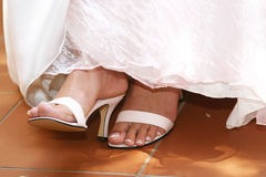 White Sandals. Brides feet with white sandals stock photo