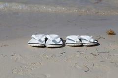 White sandals. White sandals on the beach. White sandals on the beach royalty free stock image