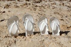 White sandals. White sandals on the beach. White sandals on the beach stock photos