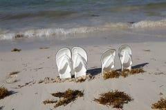 White sandals. White sandals on the beach. White sandals on the beach stock photography