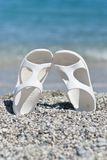White Sandals on the Beach Royalty Free Stock Image