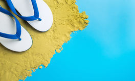 White Sandals on brown sand on blue. Copy space Stock Photography