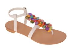 White sandals with many-coloured decoration. Royalty Free Stock Image