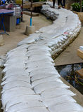 White sandbags for flood defense overlapping for pathway Stock Image
