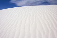 White Sands and Blue Sky. The crest of a dune in the White Sands National Monument, New Mexico, USA stock images