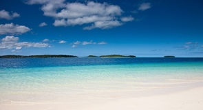 White sands and blue waters of Tonga Royalty Free Stock Photo
