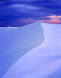 White Sands Evening. The ridge of a white sand dune in White Sands National Monument photographed in the evening Royalty Free Stock Photos