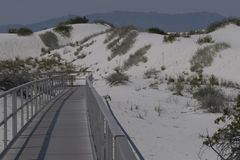 White Sands Inter dune Boardwalk. The Inter dune Boardwalk takes you a short distance into the sand dunes at White Sands National Monument in New Mexico Royalty Free Stock Photography