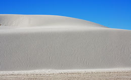 White Sands National Monument. Sand dunes and mountains against a blue sky in the White Sands National Monument Stock Photography
