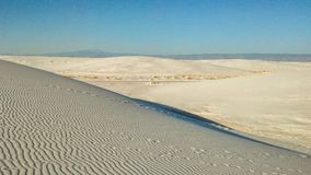 White Sands National Monument in New Mexico. White Sands National Monument is located in southern New Mexico. Wave-like ripples of glistening gypsum sand creates stock photo