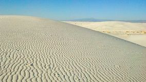 White Sands National Monument in New Mexico. White Sands National Monument is located in southern New Mexico. Wave-like ripples of glistening gypsum sand creates royalty free stock photo