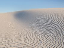 White Sands National Monument in New Mexico. White Sands National Monument is located in southern New Mexico. Wave-like ripples of glistening gypsum sand creates royalty free stock photography