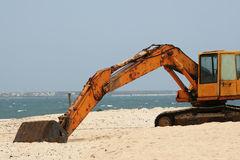 White sands and rust - environmental issues. This is an old, rusted digger on a pristine white sand beach. It shows the contrast and conflict of development and stock photos