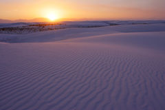 White Sands Sunset. The sun setting over the rippled dunes of the the White Sands National Monument, New Mexico, USA royalty free stock photography