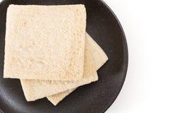 White sandwich bread slices on plate, on white background. White sandwich bread slices on plate, on white background Stock Photos