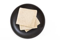 White sandwich bread slices on plate, on white background. White sandwich bread slices on plate, on white background Stock Image