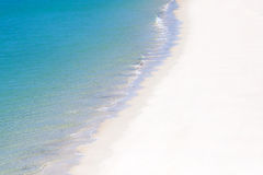 White sandy beach and blue ocean Stock Images