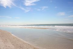White Sandy Beach and Blue Sky Royalty Free Stock Photography