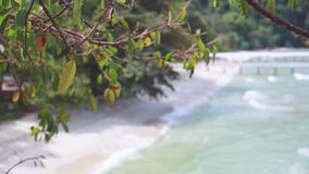 White sandy beach with blurred sea waves in Malaysia. 1920x1080 stock video footage