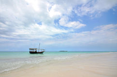 White Sandy beach with boat and Island Royalty Free Stock Photo
