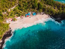 White sandy beach with coconut palms and crystal turquoise ocean in Bali. Aerial view. White sandy beach with coconut palms and crystal turquoise ocean in Bali stock photos