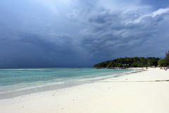 White sandy beach on stormy sky background Stock Photography