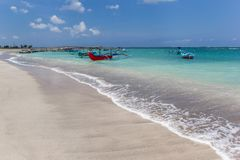 White sandy beach with traditional fishing boats in Kuta, Bali. Indonesia royalty free stock image