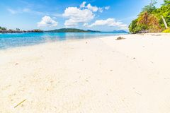 White sandy beach and turquoise water in Indonesia Royalty Free Stock Image