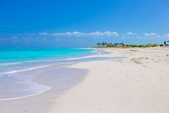 White sandy beach with turquoise water at perfect Stock Image