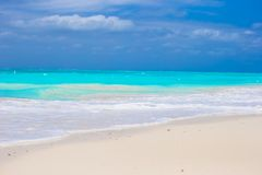 White sandy beach with turquoise water at perfect Royalty Free Stock Image