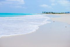 White sandy beach with turquoise water at perfect Stock Photos