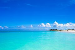 White sandy beach with turquoise water at perfect Stock Images