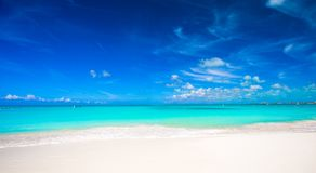 White sandy beach with turquoise water at perfect Stock Photography