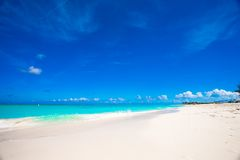 White sandy beach with turquoise water at perfect Stock Photo