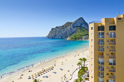 White sandy beach and view on Penon de Ifach, Calpe, Spain Stock Photos