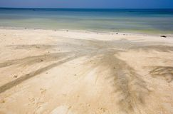 White sandy tropical beach. A deserted white sand, tropical beach and blue ocean in Thailand Stock Photo