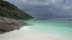 White sandy tropical beach. Over beautiful sea and cloudy sky background stock video footage