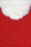 White Santa beard on red Stock Photos