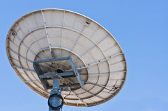 White satellite dish with blue sky Royalty Free Stock Photo