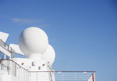 White Satellite Equipment on Ship Royalty Free Stock Photos
