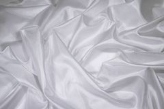 White Satin/Silk Fabric 1. Luxurious white satin/silk folded fabric, useful for backgrounds royalty free stock photography