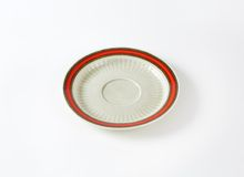 White saucer with red rim Royalty Free Stock Photos
