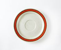 White saucer with red rim Stock Images