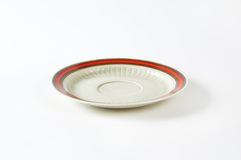 White saucer with red rim Stock Photo
