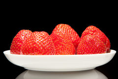 White saucer with red strawberry Stock Photos