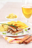 White sausage with sour cabbage royalty free stock images