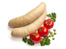 White sausage with tomato, parsley and pea Stock Photos