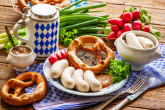 White sausages with sweet mustard and pretzel Stock Image
