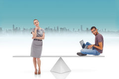 White scales weighing businesswoman and man Stock Photography