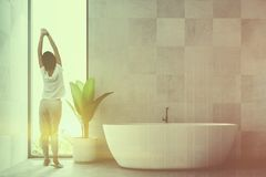White Scandinavian bathroom interior, a tub toned royalty free stock images